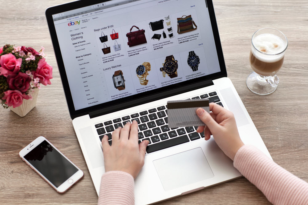 woman shops on eBay for clothing and accessories
