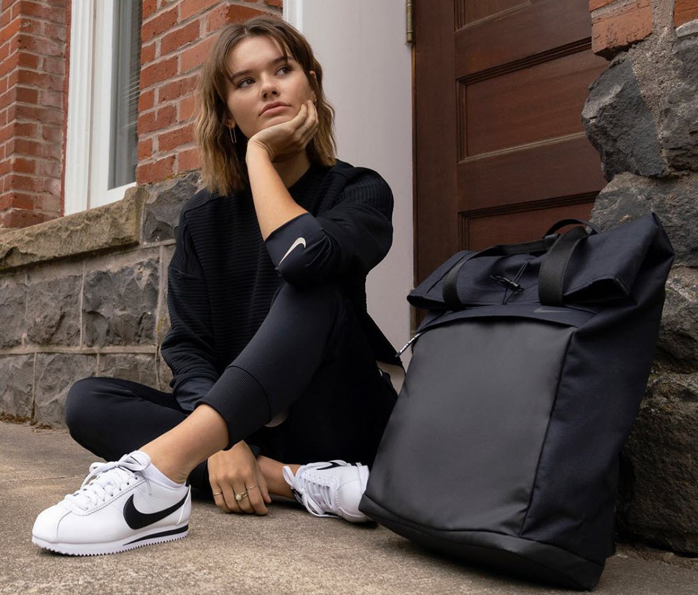 girl wears nike shoes and sporting apparel